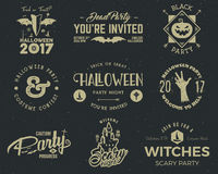 Halloween 2017 party label templates with scary symbols - zombie hand, witch hat, bat, pumpkin and typography elements Royalty Free Stock Photo
