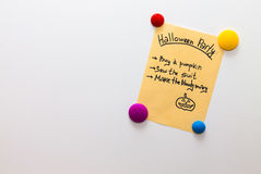 Halloween party list on the fridge note Royalty Free Stock Photo