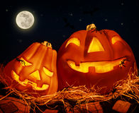 Halloween party. Night of horror, carved glowing pumpkin on full moon background, traditional autumnal holiday, fear concept Stock Image