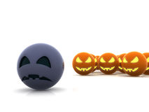 Halloween party, one sad pumpkin. One blue sad pumpkin and manny other orange and happy Stock Photo