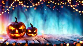 Halloween Party - Pumpkins And String Lights On Table royalty free stock photo