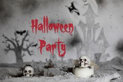 Halloween Party. Skull on an old used thick candle. Scary Hallow. Skull on an old used thick candle. Scary Halloween background. Closeup stock image