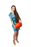 Halloween party. Smiling girl with a great pumpkin. On white background Royalty Free Stock Photos