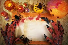 Halloween Party. Halloween theme party accessories with monster hand on wooden background , Top view or flat lay with copy space Royalty Free Stock Photo