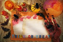 Halloween Party, Trick or Treat. Halloween theme party accessories with monster hand on wooden background , Top view or flat lay with copy space Royalty Free Stock Photos