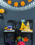 Halloween party. Two lonely chairs stand in the middle of a Halloween party stock photo