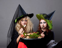 Halloween party - women in costumes of witches Stock Image