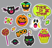 Halloween patch badges. Halloween patch badges with ghost and pumpkin, candy and cat, owl and cupcake, skull and bat, speech bubbles. Set of fashion stickers vector illustration