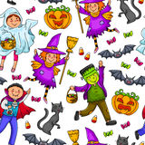 Halloween pattern. Seamless pattern with h kids in Halloween costumes Royalty Free Stock Photo
