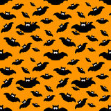 Halloween pattern with bats over orange background Royalty Free Stock Photos