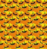 Halloween pattern with bats and pumpkins Stock Image