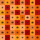 Halloween pattern with pumpkins and bones on multicolor squares. Stock Photo