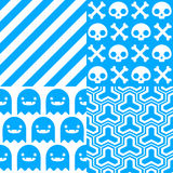 Halloween Patterns. Set of patterns for October 31st with classic halloween icons in blue and white Stock Photography