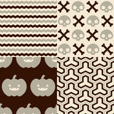 Halloween Patterns. Set of patterns for October 31st with classic halloween icons. It has subtle colors Stock Photos