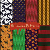 Halloween patterns set. A pack with eight seamless vector patterns for your halloween design. hand-drawn ghosts, cats and skulls and some geometric patterns in Royalty Free Stock Photography