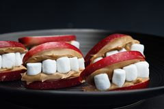 Halloween Peanut Butter and Apple Mouths Royalty Free Stock Image