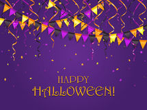 Halloween pennants and streamers on violet background Stock Photo