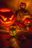 Halloween pepper and pumpkin still life. With candles Royalty Free Stock Images