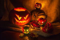 Halloween peppers and pumpkin still life. Halloween pumpkin still life with candles Stock Photos