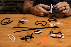 Halloween pipe-cleaner and construction paper crafts featuring Black Cats