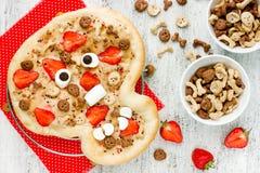 Halloween pizza recipe for kids, sweet tart skull with strawberr Stock Images