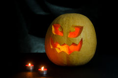 Halloween - Pompoen hefboom-o-lantaarn op zwarte achtergrond Royalty-vrije Stock Foto