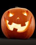 Halloween-pompoen, Jack O'Lantern op zwarte Royalty-vrije Stock Afbeelding