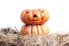 Halloween-pompoen op het hooi op een witte geïsoleerde achtergrond Royalty-vrije Stock Foto's