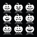 Halloween-pompoenpictogrammen op zwarte achtergrond worden geplaatst die Stock Foto's