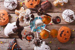 Halloween Pop cakes and gingerbread cookies. horizontal top view. Halloween Pop cakes and gingerbread cookies on the table. horizontal view from above Royalty Free Stock Photo