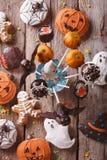 Halloween Pop cakes and gingerbread cookies. vertical top view. Halloween Pop cakes and gingerbread cookies on the table. vertical top view Stock Image