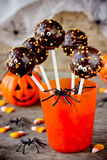 Halloween pop cakes in orange glass for Halloween party vertical. Background selective focus Stock Images