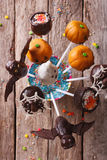 Halloween pop cakes on a table close-up. vertical top view Stock Photo