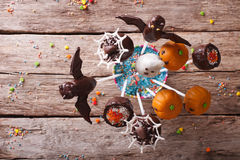 Halloween pop cakes on a table. horizontal top view. Festive Halloween pop cakes on a table. horizontal top view Royalty Free Stock Image