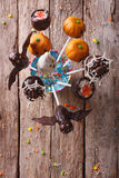 Halloween pop cakes on a table. vertical top view. Festive Halloween pop cakes on a table. vertical top view Stock Images