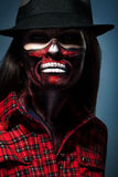 Halloween portrait of woman with face art Royalty Free Stock Images