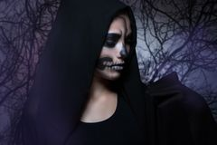Halloween portrait of young beautiful girl in a black hood. stock images