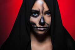 Halloween. Portrait of a young beautiful girl with skeleton makeup on her face. royalty free stock photos