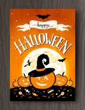 Halloween postcard with moon and pumpkins. Halloween postcard design with lettering, moon and pumpkins on wood background Royalty Free Stock Photo