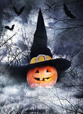 Halloween poster with pumpkin in witch hat. On foggy background Stock Image