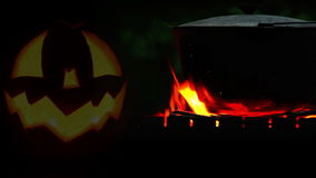 Halloween Pot on the campfire footage stock video