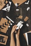 Halloween preparation. Hands making halloween cards and decoration using craft paper Royalty Free Stock Photos