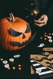 Halloween preparation. Hands making halloween cards using craft paper Stock Images