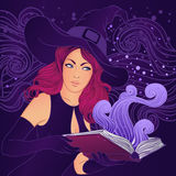 Halloween pretty witch with a magic book Royalty Free Stock Photography