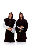 Halloween priests. Holiday religious Halloween scene, two priests in habit.  Studio, white background Stock Photography