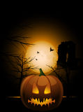 Halloween pumkin and abbey. Halloween pumpkin with carved face in front of abbey and trees with full moon and bats in the background Royalty Free Stock Photo