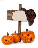Halloween Pumkins. Halloween Pumpkins with wooden post isolated on white background Stock Image