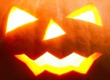 Halloween pumpa med läskig framsidanärbild fotografering för bildbyråer