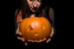 Halloween pumpkin. A person holding a halloween pumpkin Royalty Free Stock Photo