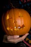 Halloween pumpkin. A person holding a halloween pumpkin Stock Photos
